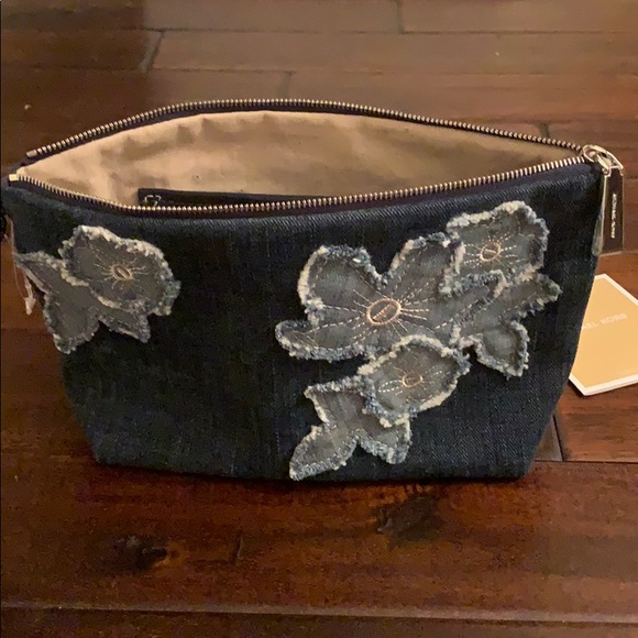 Michael Kors Handbags - Michael Kors Denim Floral Zip Clutch LIKE NEW!!!